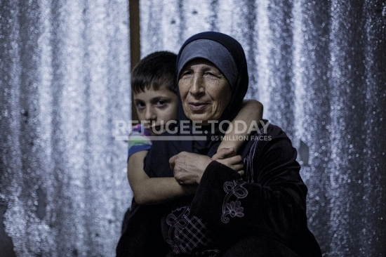 Grandmother and grandchild in refugee camp