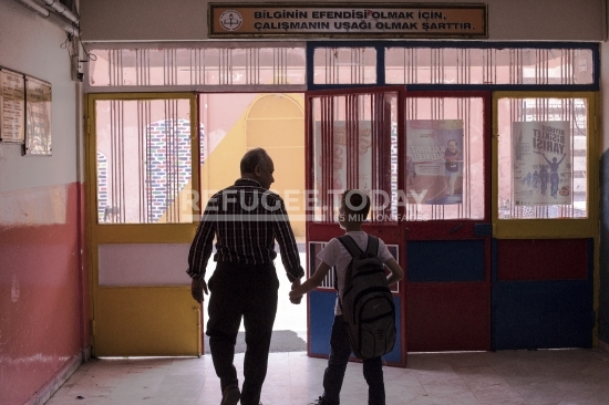 Father and son on their way to school